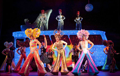"Wade McCollum, Scott Willis and Bryan West  bring color and flash (not to mention, some flesh) to ""Priscilla Queen of the Desert The Musical."""
