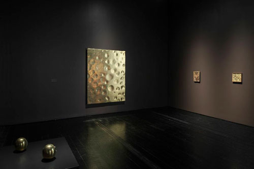 Works by Lucio Fontana, Yves Klein and Robert Rauschenberg join Byzantine icons in this dark, theatrically lit room. Photo courtesy of the Menil Collection.