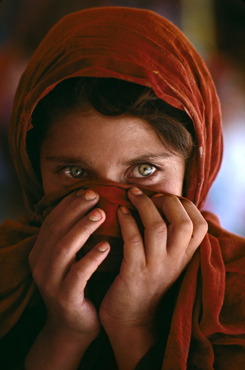 """Afghan Girl Hiding Face"" by Steve McCurry"