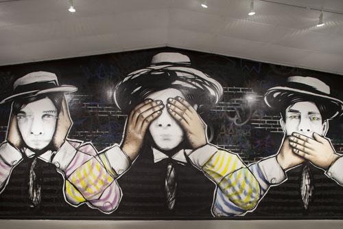 "Dual's mural features a ""hear no evil; see no evil; speak no evil"" theme. Photo: Michael Stravato."