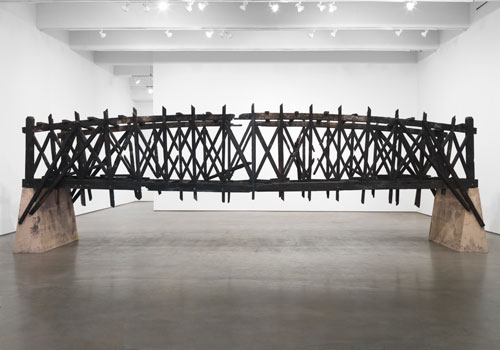 Marianne Vitale. Burned Bridge, 2012. Reclaimed lumber. Photo courtesy of Zach Feuer Gallery, New York.