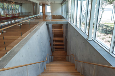 View of the double staircase leading to the lower level. Renzo Piano Pavilion, November 2013 Kimbell Art Museum, Fort Worth. Photo by Robert Polidori.