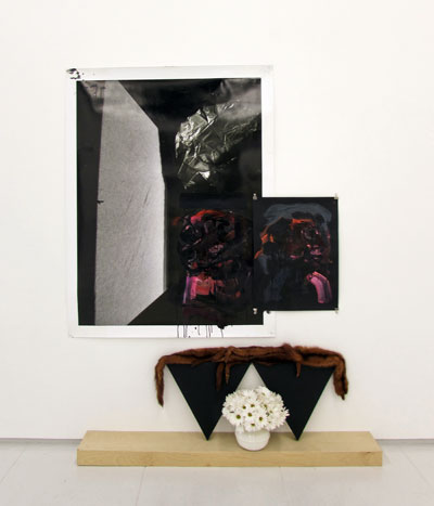 "Raychael Stine, Moons for Moons, 2012.  Digital photograph, acrylic paint, black bond, postcard, triangle canvas, wooden shelf, weasel pelts, women's spittoon, white daisy mums.  6' x 6' x 10"". Courtesy of the artist and Art Palace."