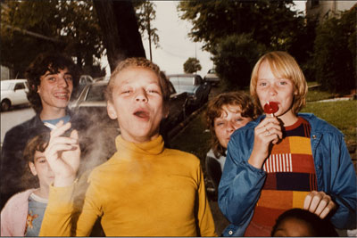 Mark Cohen (b. 1943). Boy in Yellow Shirt Smoking, 1977. Dye coupler print © Mark Cohen. Courtesy the artist and ROSEGALLERY.