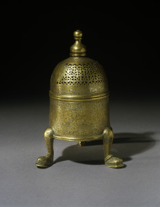 Incense burner of the Ayyubid Sultan al-Adil II Mosul (Iraq), 1238-1240 Brass, inlaid with silver 7 7/8 x 3 5/8 in. (20 x 9.3 cm) The Keir Collection of Islamic Art on loan to the Dallas Museum of Art