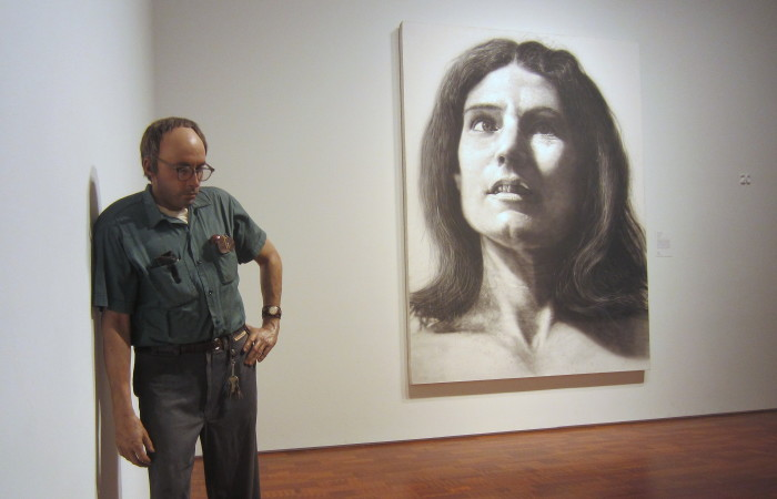 From left: Duane Hanson, Janitor, 1973; Chuck Close, Nancy, 1968. Milwaukee Art Museum