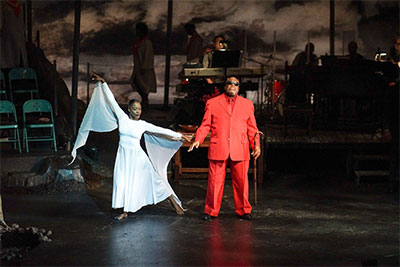 Christa Oliver and Tim Curry in The Gospel at Colonus. Photo by Kirk Tuck.