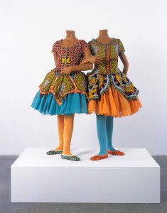 Yinka Shonibare MBE, Girl Girl Ballerina,2007. Mannequins, Dutch wax printed cotton textile, and guns. 49 1/2 x 29 x 21 1/4 inches and 49 1/2 x 27 1/2 x 25 1/4 inches. © the artist. Photograph by Stephen White.