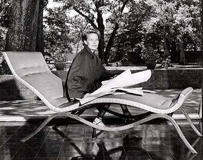 Dominique de Menil wearing a Charles James designed day suit seated on a chaise longue of his design, patio of Menil House (detail). The Menil Archives, the Menil Collection, Houston. Courtesy of Charles B. H. James and Louise D. B. James. Photo: F. Wilbur Seiders.