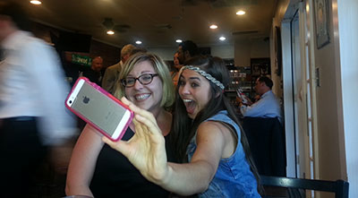 Mandy Graessle and Danielle Gonzaba take a selfie. Photo by Mark Wozny.