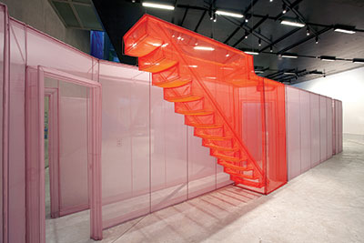 Do Ho Suh, Apartment A, Unit 2, Corridor and Staircase, 348 West 22nd Street, New York, NY 10011, USA, 2011–2012. Polyester fabric and stainless steel tubes. Apartment A, 271 2/3 x 169 3/10 x 96 7/16 inches. Unit 2, 422 7/16 x 228 1/3 x 96 1/16 inches. Corridor and Staircase, 488 3/16 x 66 1/8 x 96 7/16 inches. Courtesy the artist and Lehmann Maupin, New York and Hong Kong.