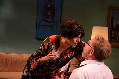 Gloria Sanchez as Martha  and David Connelly as George in the AtticRep production of Edward Albee's Who's Afraid of Virginia Woolf? Photo by Siggi Ragnar.