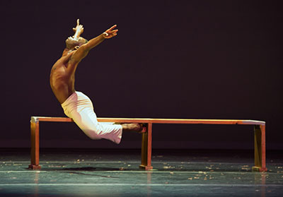 Dallas Black Dance Theatre's Tyrell V. Rolle in Talley Beatty's Mourner's Bench. Photo by Jaime Truman.