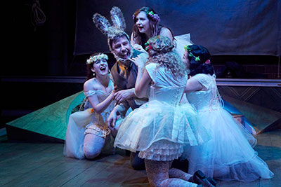 Drake Simpson as Bottom with (left to right) Molly Searcy, Hannah Kreig, Skyler Sinclair, and Regina Ohashi as Fairies.