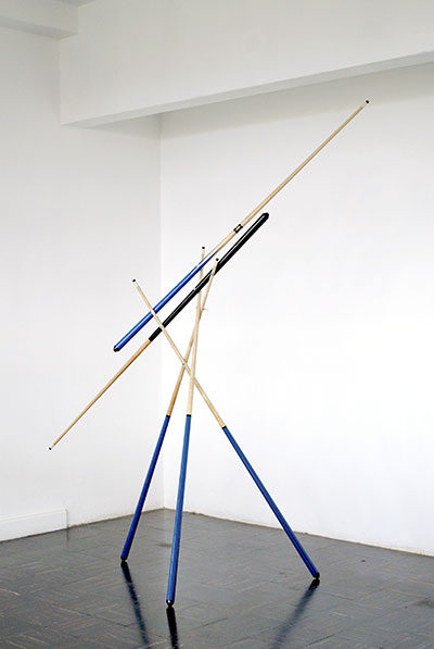 Darío Escobar, Juego a cinco manos (Five handed game), 2008. Wood, rubber, bronze, and plastic, 118 1/8 x 19 3/4 x 19 3/4 in.