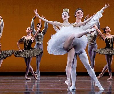 Jared Matthews, Yuriko Kajiya and Artists of Houston Ballet in Stanton Welch's Paquita. Photo by Amitava Sarkar.