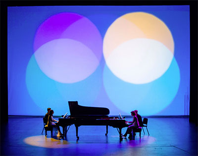 Marilyn Nonken, left and Sarah Rothenberg, right in Sacred Visions: Messiaen and Stravinsky at Wortham Theater Center, May 2, 2015 with lighting design by Jennifer Tipton. Photo by Ben Doyle