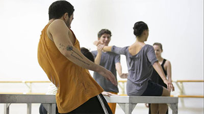 Mario Zambrano working with Hubbard Street Dance Chicago working with Ayman Harper set William Forsythe's One Flat Thing Reproduced. Photo courtesy of the artist.