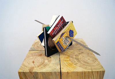Slavs and Tatars, Kitab Kebab (USA Tudeh), 2014. Books, metal kebab skewer, ~ 50 x 50 x 50cm. Collection of Fred and Soody Sharifi. Courtesy the artists and Tanya Bonakdar Gallery.