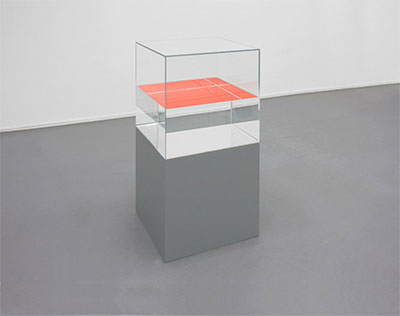 Ann Veronica Janssens, Orange, 2010, (50 x 50 x 101 cm), Glass, paraffin oil, fluo serigraph, and painted wooden base, Courtesy Esther Schipper Gallery. Photo: Andrea Rossetti. © Ann Veronica Janssens.
