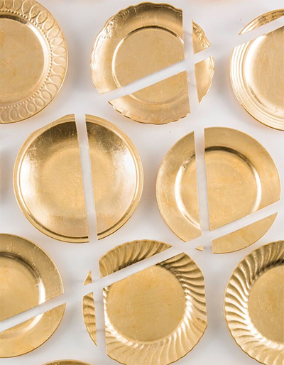 Amelia Toelke, Light and Shadow (detail), 2012. Altered plates and faux gold leaf. Photo by Jim Escalante.