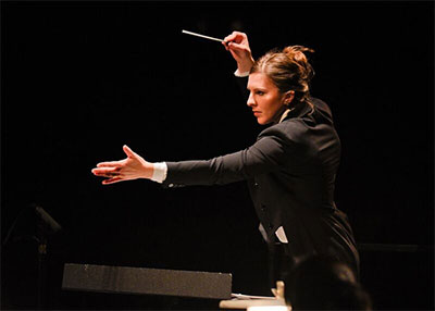 Lidiya Yankovskaya from the U.S. conducting The Dallas Opera Orchestra. Photo by Karen Almond, Dallas Opera.