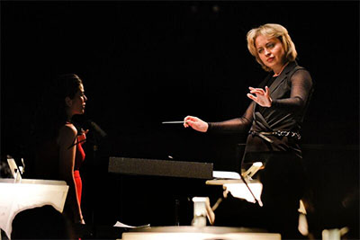 "Anna Skryleva, a Russian conductor working primarily in Germany, conducts soprano Sarah Jane McMahon and The Dallas Opera Orchestra in ""Things Change, Jo"" from Mark Adamo's opera Little Women. Photo by Karen Almond, Dallas Opera."