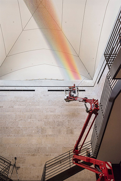 Gabriel Dawe installing Plexus no. 34 at the Amon Carter Museum of American Art. Courtesy Amon Carter Museum of Art.