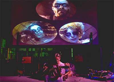 Acoustic Nerves, a city-funded experimental performance, was shut down by the fire marshall. Pictured: Dean Terry at center, behind (Clockwise from bottom left: Hannah Weir, Abel Flores, and Hilly Holsonback). Photo by Alisa Eykilis.