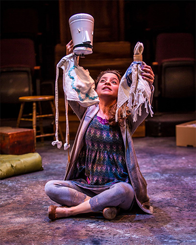 Gricelda Silva transforms every-day objects into puppets in ZACH Theatre's 2015 bilingual production of Cenicienta in partnership with Teatro Vivo. Photo by AxelB Photography.