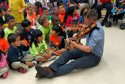 Community-Embedded Musician Tony Parce interacts with students at Crespo Elementary. Photo courtesy of Houston Symphony.