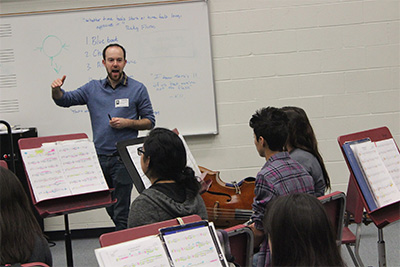 David Connor teaches band students at Galena Park High School. Photo by Kristen Bennett.