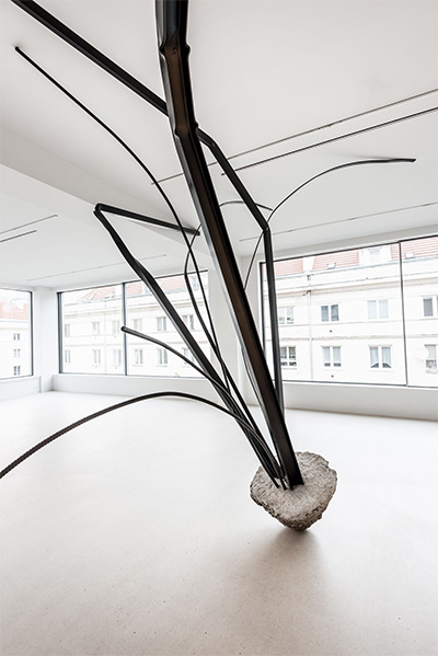Monika Sosnowska, Untitled, 2015. Concrete and painted steel. 119 1/4 x 127 1/2 x 157 1/2 inches. Installation view, Monika Sosnowska: Still Life, Foksal Gallery Foundation, Warsaw. Artwork © Monika Sosnowska. Courtesy the artist; Foksal Gallery Foundation, Warsaw; The Modern Institute, Glasgow; Galerie Gisela Capitain, Cologne; kurimanzutto, Mexico City; and Hauser & Wirth. Photograph by Bartosz Górka.